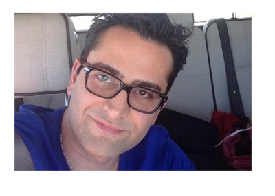 Antonio Esfandiari in the passenger seat of a car.  Twitter photo