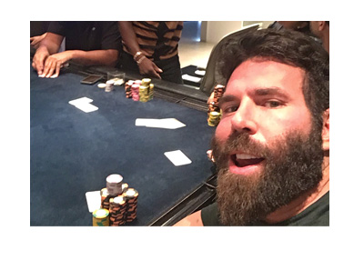 Dan Blizerian at the poker table taking a selfie.  Nice stack of chips.