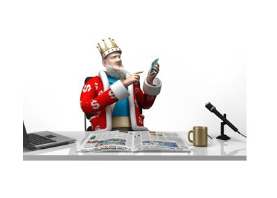 The King is at the office desk pointing towards his mobile phone.