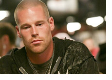 Patrik Antonius stares down at the cards on the table