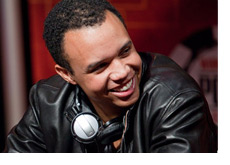 Phil Ivey at the table smiling - Wearing a black leather jacket - Photo updated on Sept 27th 2010 - at the WSOPE