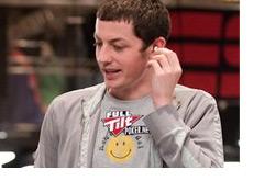-Tom Dwan standing up - Wearing a smiley face shirt