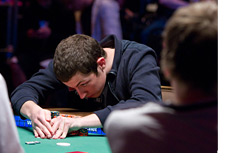 Tom Dwan taking a peek at the cards he was dealt