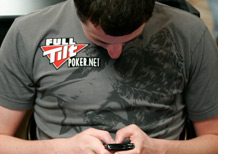 -- Tom Dwan playing on his mobile phone --