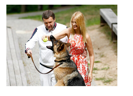 Tony G, Aiste Slapokaite and their German Shepherd